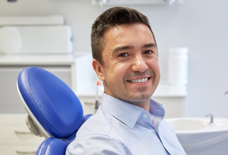 General dentistry patient in dental chair at Lakeridge Dental.
